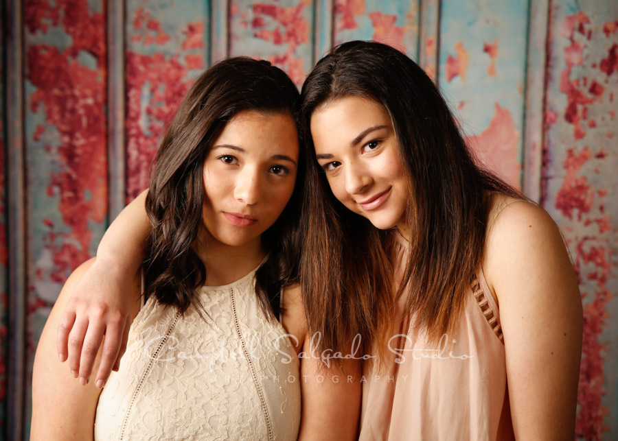 Portrait of sisters on Italian rust background by family photographers at Campbell Salgado Studio in Portland, Oregon.