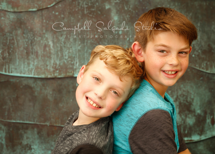 Portrait of boys on ocean weave background by children's photographers at Campbell Salgado Studio in Portland, Oregon.