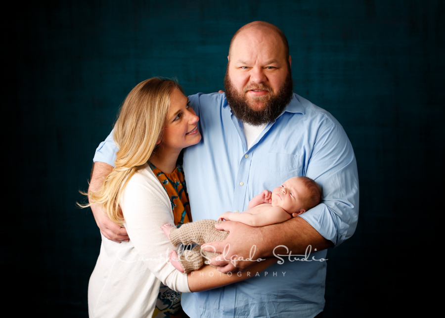 Portrait of family on deep ocean background by newborn photographers at Campbell Salgado Studio in Portland, Oregon.