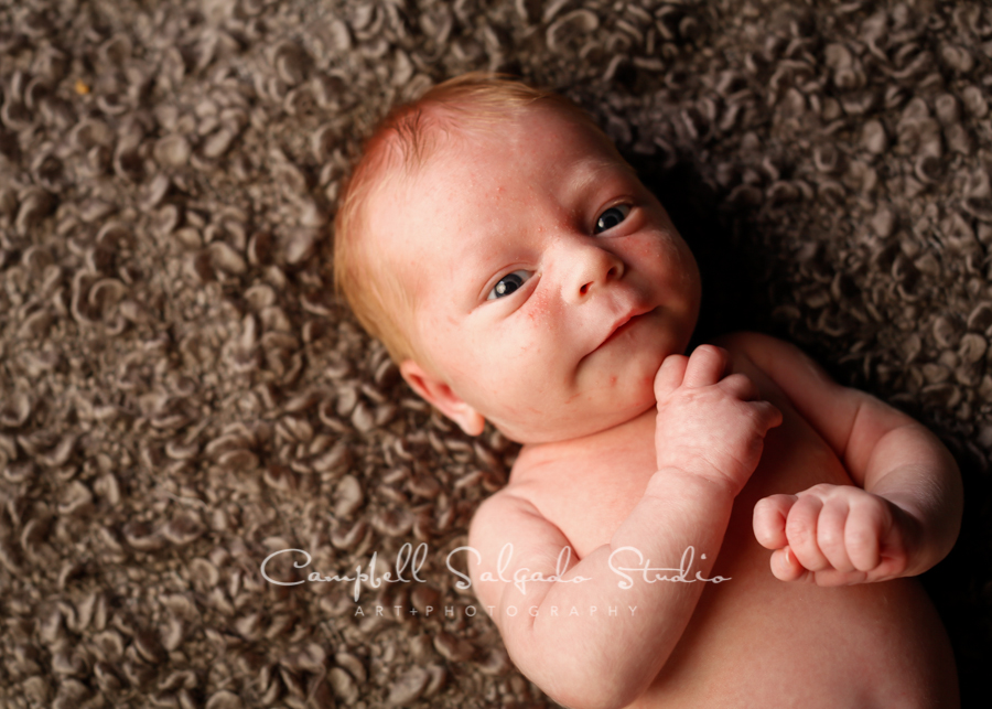 Portrait of newborn on blankies background by newborn photographers at Campbell Salgado Studio in Portland, Oregon.