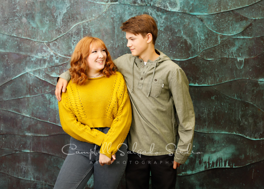Portrait of teens on ocean weave background by teen photographers at Campbell Salgado Studio in Portland, Oregon.