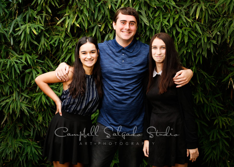 Portrait of siblings on bamboo background by family photographers at Campbell Salgado Studio in Portland, Oregon.