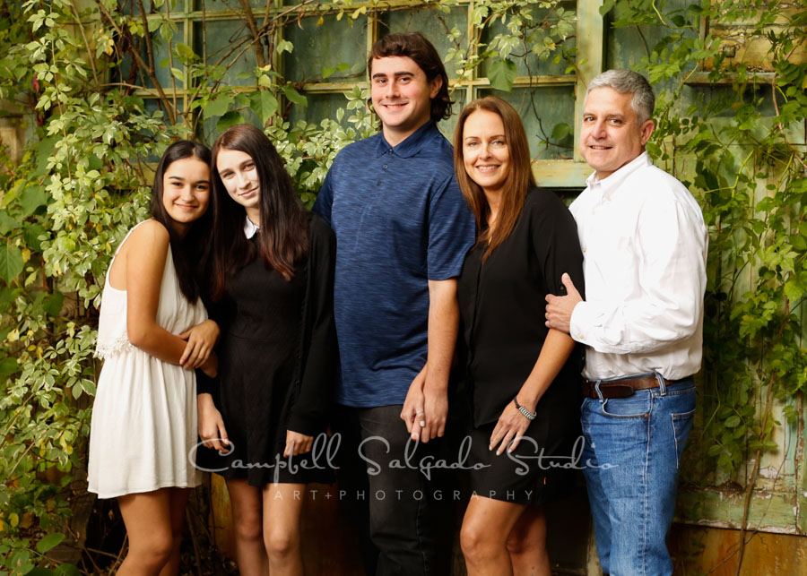 Portrait of family on vintage green doors background by family photographers at Campbell Salgado Studio in Portland, Oregon.