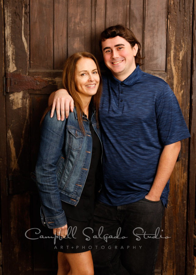 Portrait of mother and son on rustic door background by family photographers at Campbell Salgado Studio in Portland, Oregon.