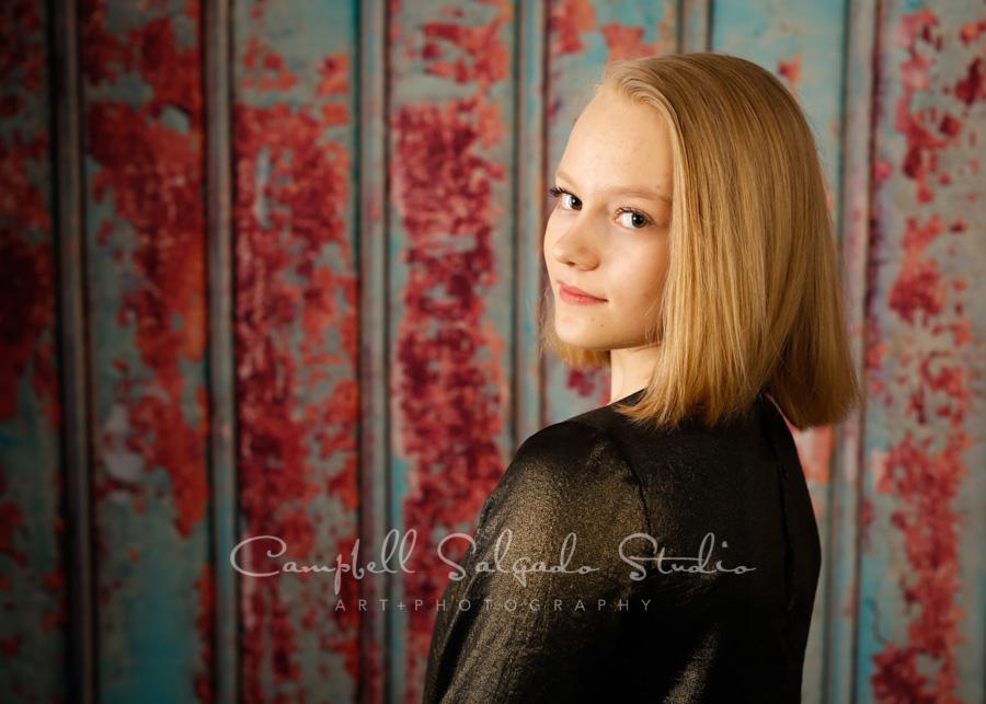 Portrait of teen on Italian rust background by teen photographers at Campbell Salgado Studio in Portland, Oregon.