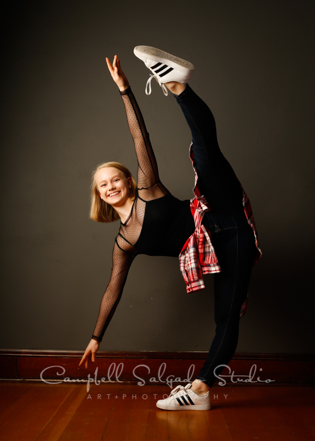 Portrait of teenage dancer on grey background by teen photographers at Campbell Salgado Studio in Portland, Oregon.
