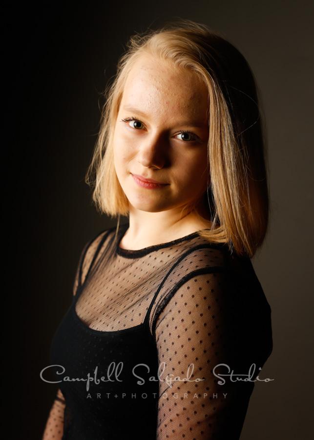 Portrait of teen on grey background by teen photographers at Campbell Salgado Studio in Portland, Oregon.