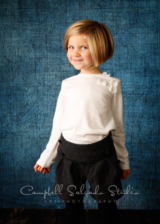 Portrait of child on denim background by children's photographers at Campbell Salgado Studio in Portland, Oregon.