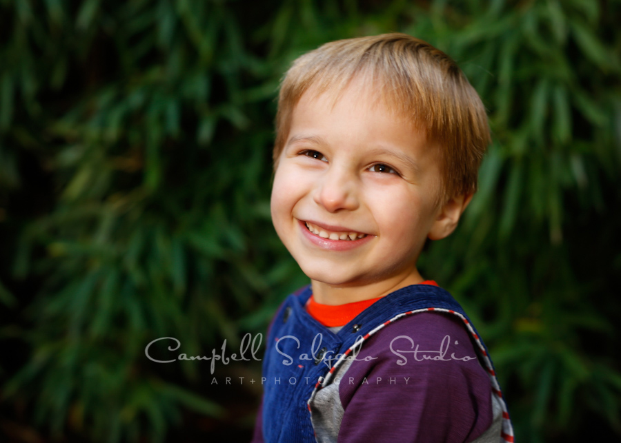 Portrait of child on bamboo background by child photographers at Campbell Salgado Studio in Portland, Oregon.