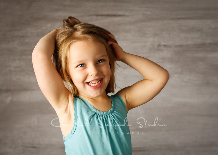 Portrait of girl on graphite background by children's photographers at Campbell Salgado Studio in Portland, Oregon.