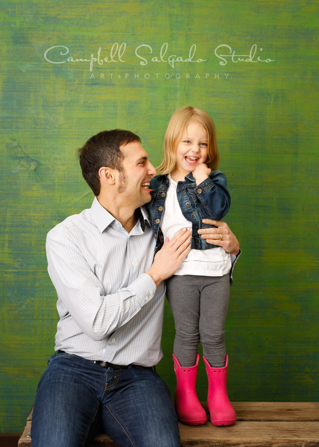 Portrait of father and daughter on blue-green weave background by family photographers at Campbell Salgado Studio in Portland, Oregon.