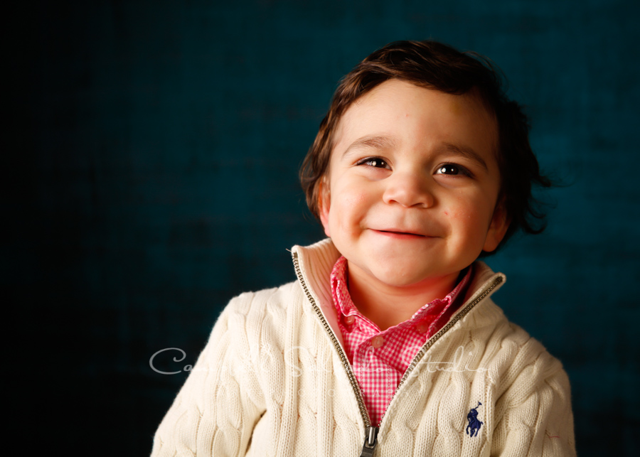Portrait of toddler on deep ocean background by child photographers Campbell Salgado Studio in Portland, Oregon.