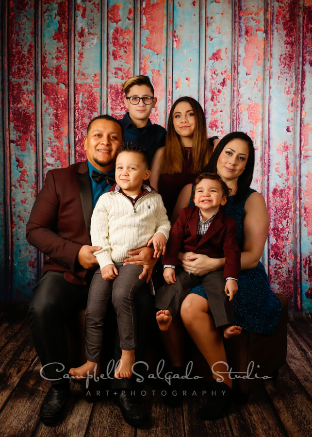 Portrait of family on Italian rust background by family photographers Campbell Salgado Studio in Portland, Oregon.