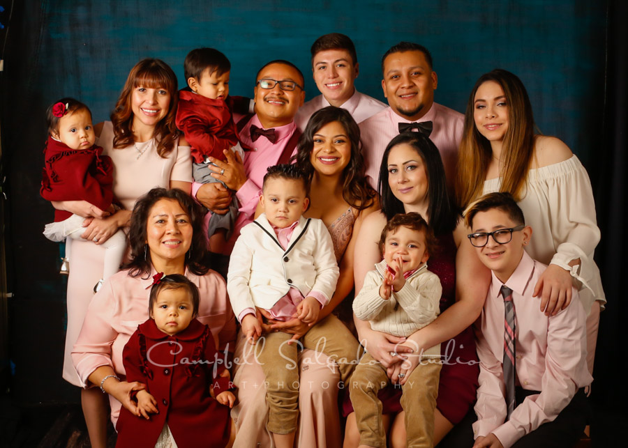 Portrait of multi-generational family on deep ocean background by family photographers Campbell Salgado Studio in Portland, Oregon.