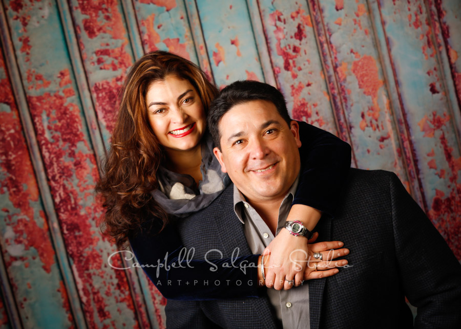 Portrait of couple on Italian rust background by couples photographers at Campbell Salgado Studio in Portland, Oregon.