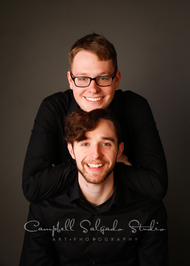 Portrait of brothers on grey background by family photographers at Campbell Salgado Studio in Portland, Oregon.