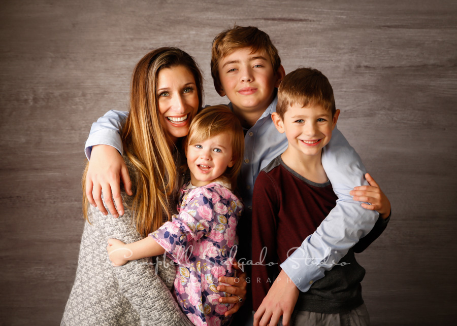 Portrait of family on graphite background by family photographers at Campbell Salgado Studio in Portland, Oregon.