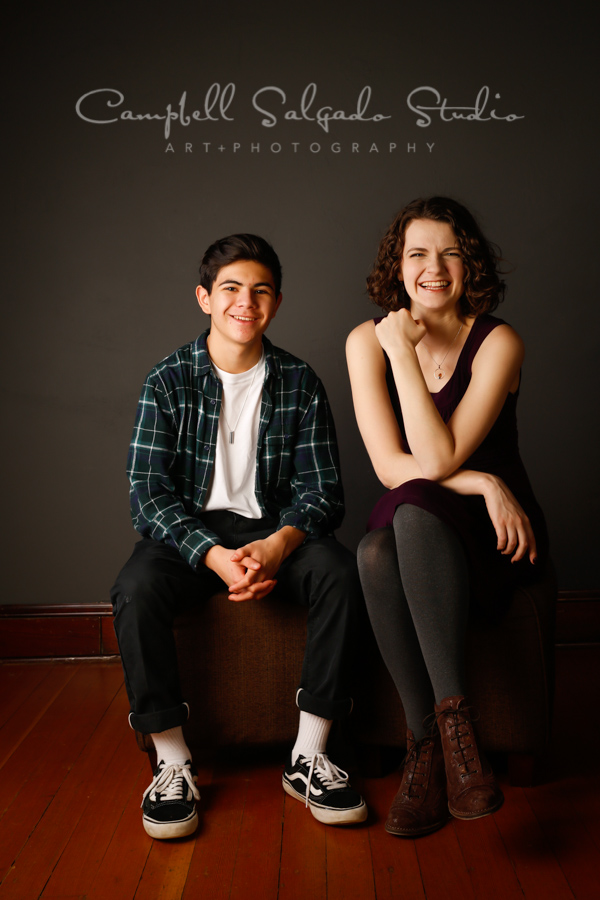 Portrait of siblings on grey background by family photographers at Campbell Salgado Studio in Portland, Oregon.
