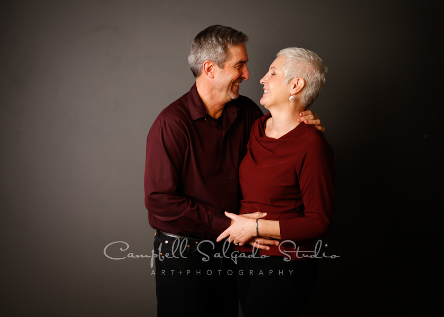 Portrait of couple on grey background by family photographers at Campbell Salgado Studio in Portland, Oregon.