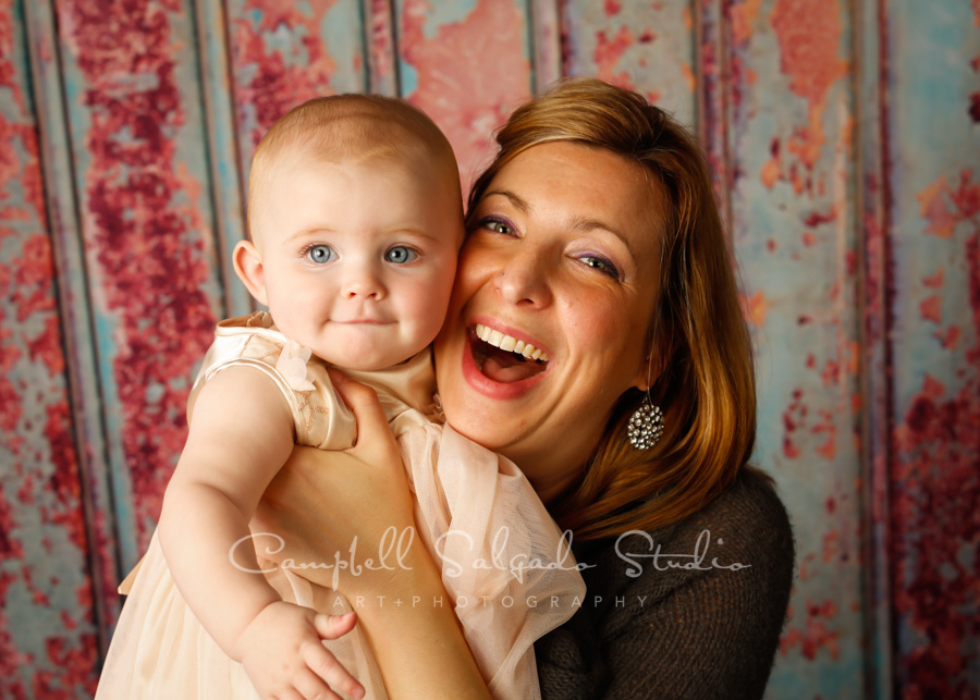 Portrait of family on Italian rust background by baby photographers at Campbell Salgado Studio in Portland, Oregon.