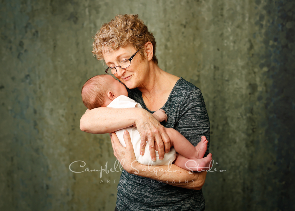Portrait of grandma and grandson on rain dance background by newborn photographers at Campbell Salgado Studio in Portland, Oregon.