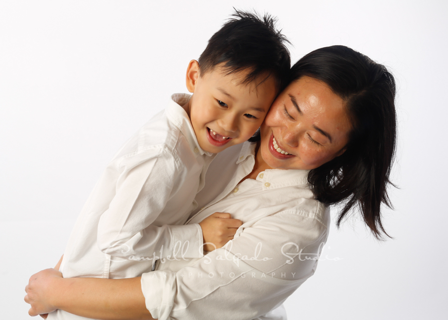 Portrait of mother and son on white background by family photographers at Campbell Salgado Studio in Portland, Oregon.
