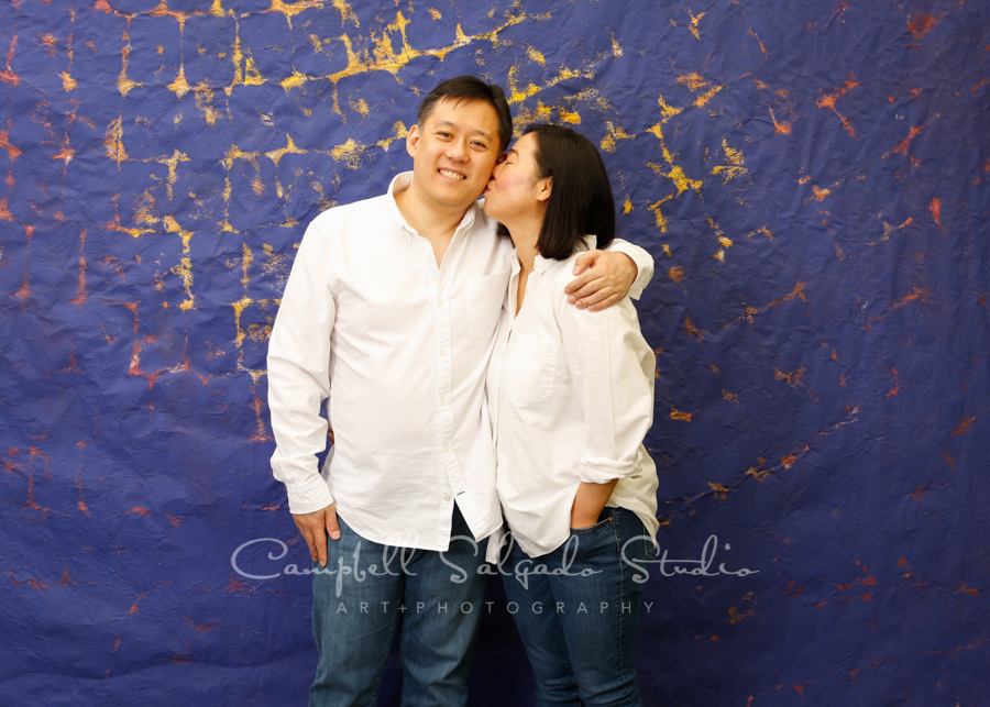Portrait of couple on the Frida background by couples photographers at Campbell Salgado Studio in Portland, Oregon.