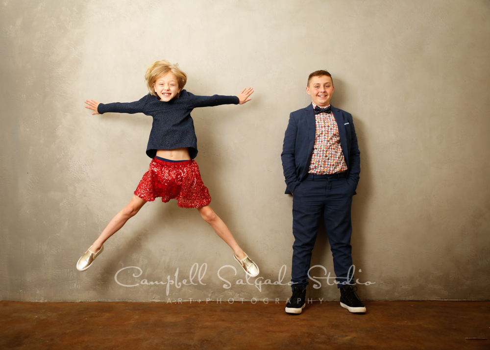 Portrait of kids on modern grey background by child photographers at Campbell Salgado Studio in Portland, Oregon.