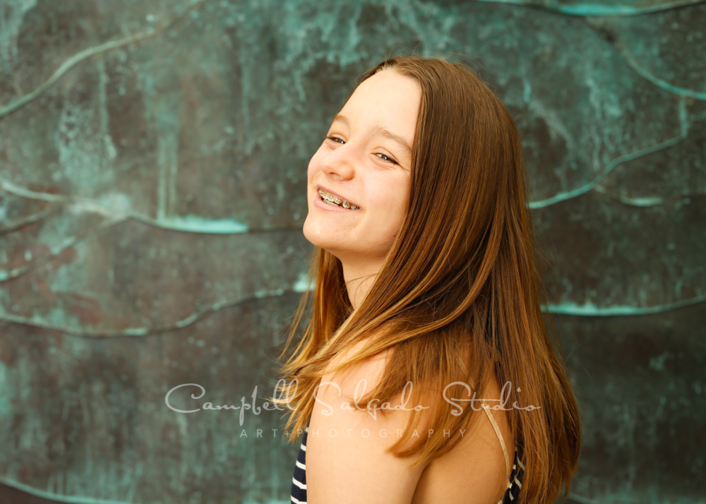 Portrait of teenager on ocean weave background by family photographers at Campbell Salgado Studio in Portland, Oregon.