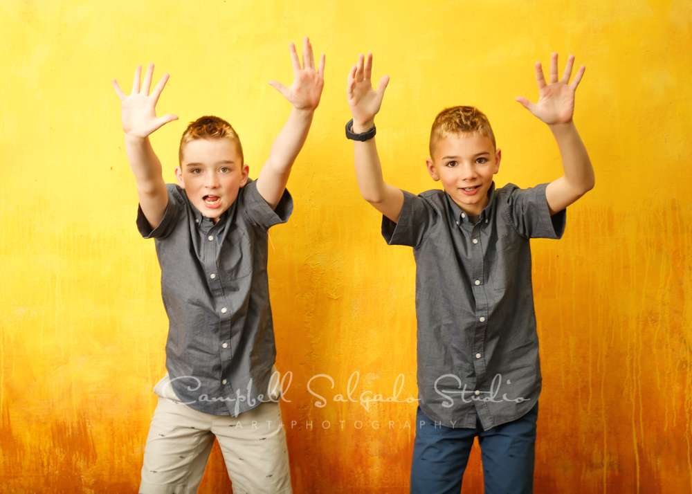 Portrait of twins on liquid sunshine background by child photographers at Campbell Salgado Studio in Portland, Oregon.