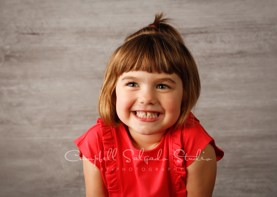 Portrait of girl on graphite background by child photographers at Campbell Salgado Studio in Portland, Oregon.