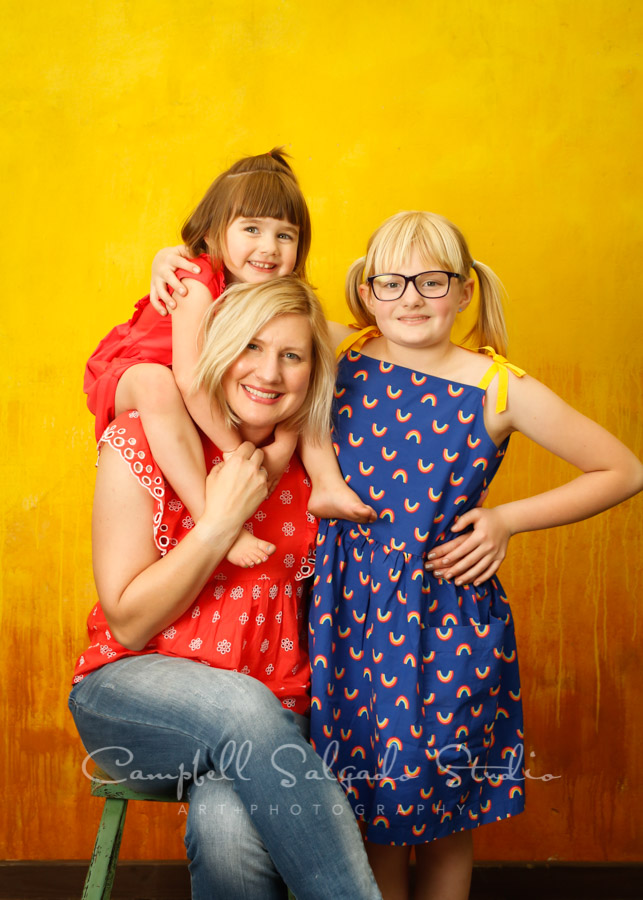 Portrait of mother and daughters on liquid sunshine background by family photographers at Campbell Salgado Studio in Portland, Oregon.