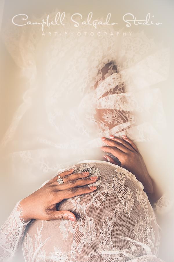 Milk bath maternity photo of a woman wearing white lace at Campbell Salgado Studio in Portland, Oregon.