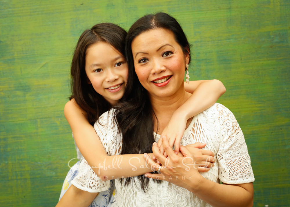 Portrait of mother and daughter on blue green weave background by family photographers at Campbell Salgado Studio in Portland, Oregon.