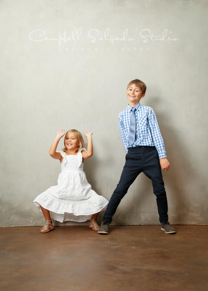Portrait of kids on modern grey background by childrens photographers at Campbell Salgado Studio in Portland, Oregon.