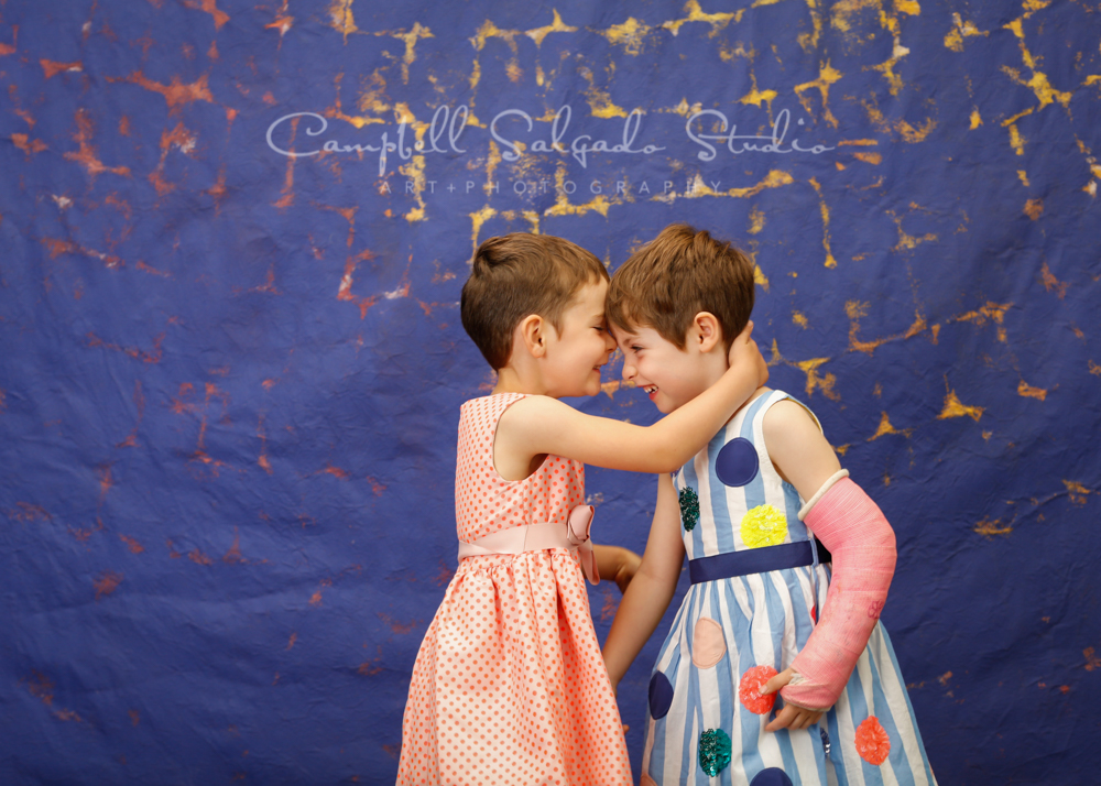 Portrait of children on the Frida background by child photographers at Campbell Salgado Studio in Portland, Oregon.