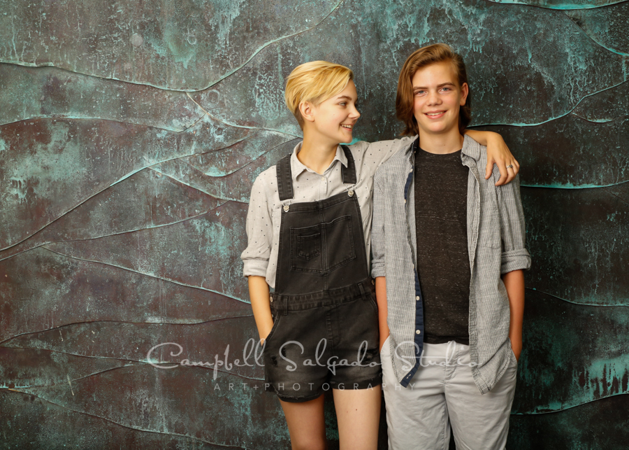 Portrait of teens on ocean weave background by family photographers at Campbell Salgado Studio in Portland, Oregon.