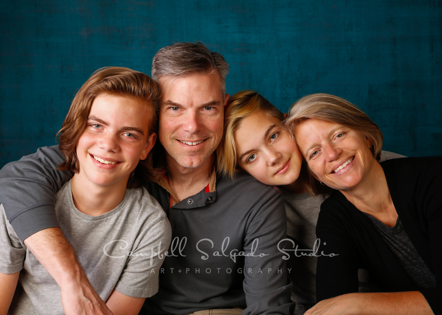 Portrait of family on deep ocean background by family photographers at Campbell Salgado Studio in Portland, Oregon.