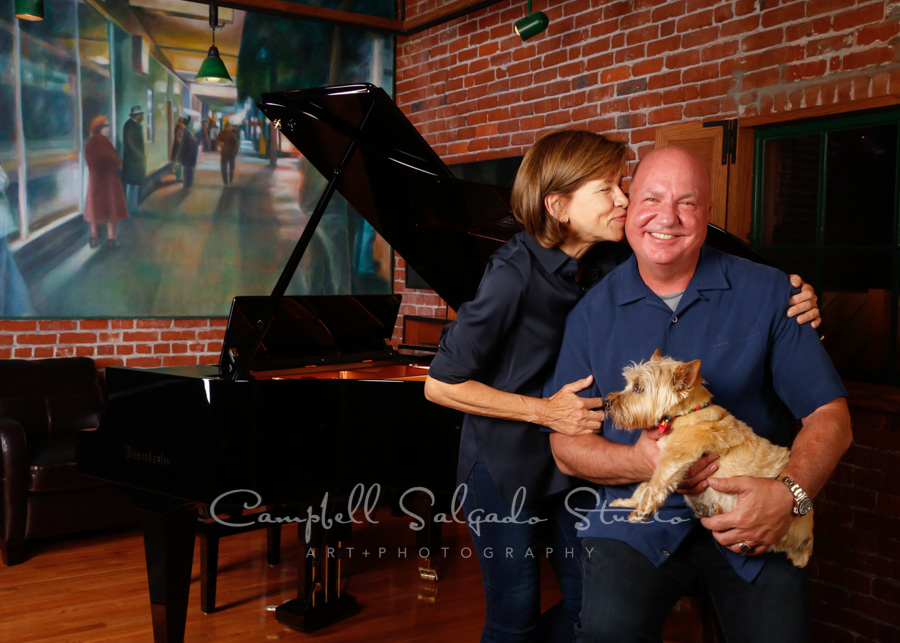 Portraits of family at piano store background by family photographers at Campbell Salgado Studio in Portland, Oregon.
