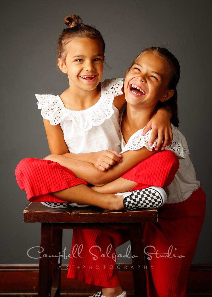 Portrait of children on gray background by children's photographers at Campbell Salgado Studio in Portland, Oregon.