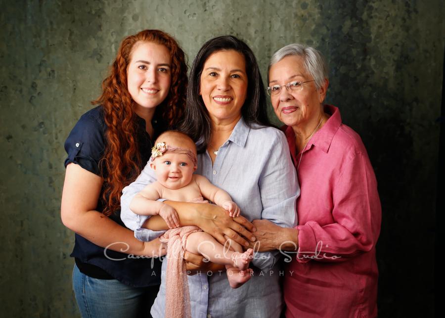 Multi generational portrait of women on rain dance background by family photographers at Campbell Salgado Studio in Portland, Oregon.