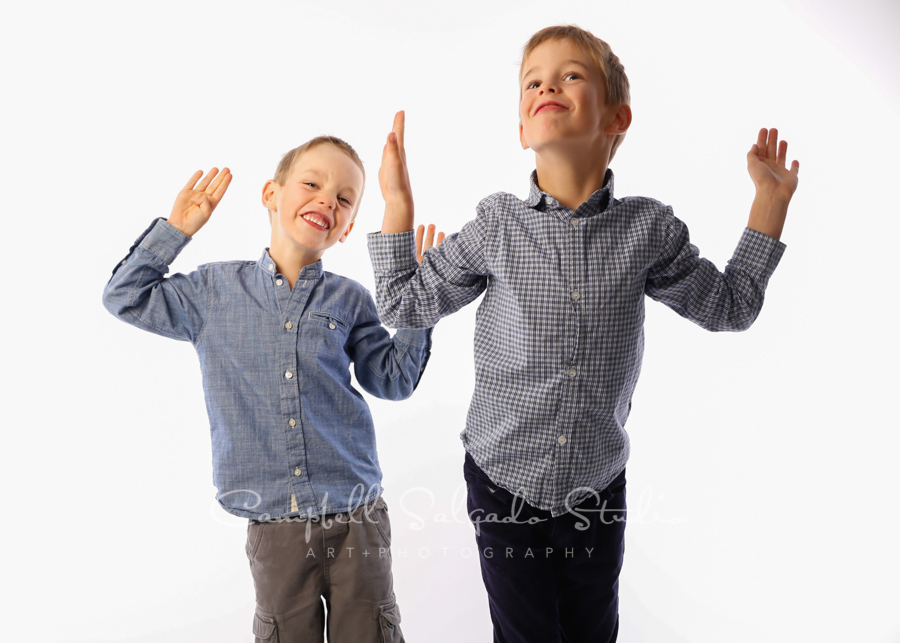 Portrait of kids on white background by child photographers at Campbell Salgado Studio in Portland, Oregon.