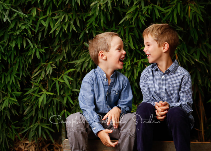 Portrait of kids on bamboo background by child photographers at Campbell Salgado Studio in Portland, Oregon.