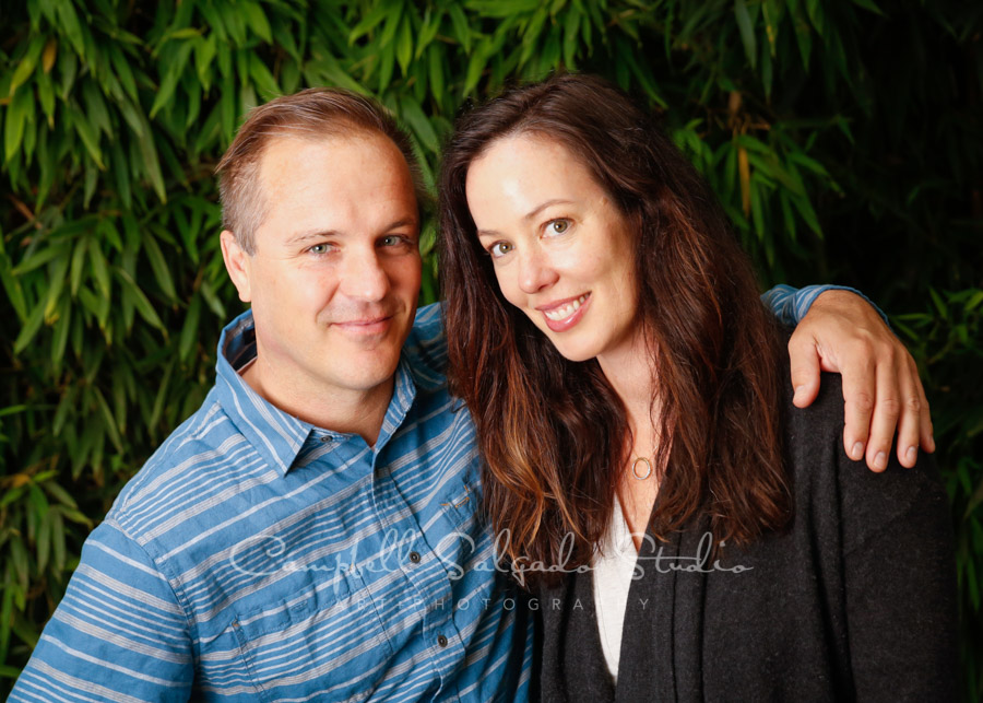 Portrait of couple on bamboo background by couples photographers at Campbell Salgado Studio in Portland, Oregon.
