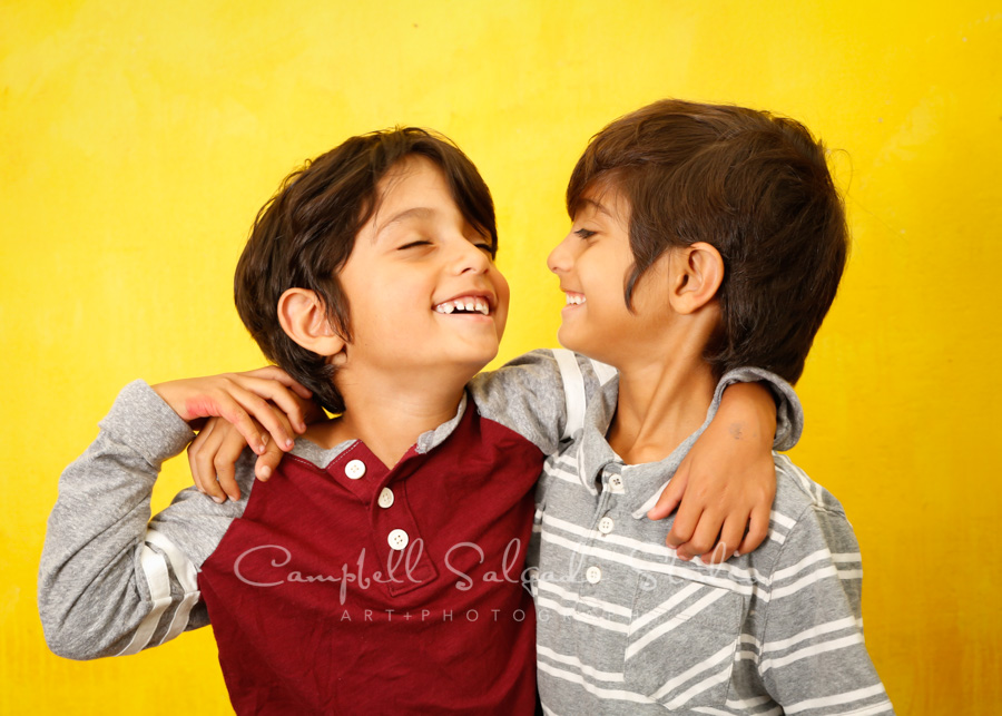 Portrait of boys on liquid sunshine background by childrens photographers at Campbell Salgado Studio in Portland, Oregon.