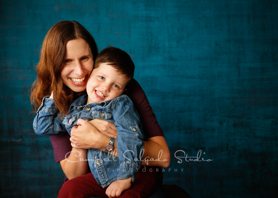 Portrait of mother and child on deep ocean background by children's photographers at Campbell Salgado Studio in Portland, Oregon.