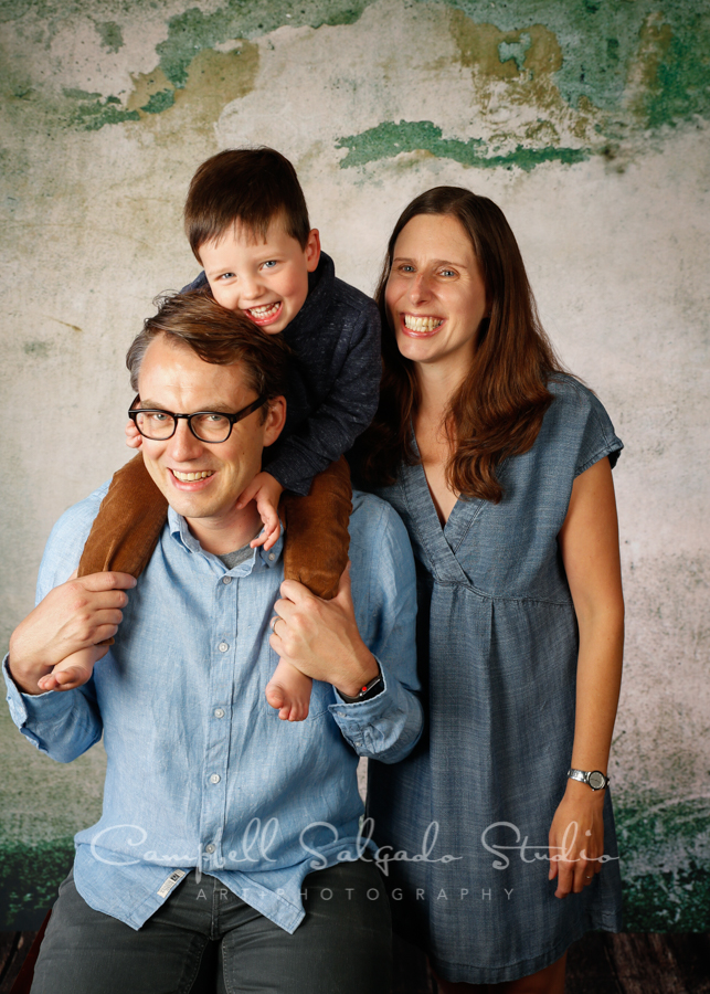 Portrait of family on abandoned concrete background by family photographers at Campbell Salgado Studio in Portland, Oregon.