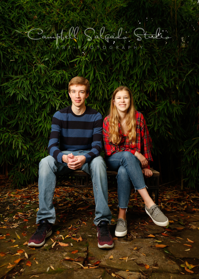 Portrait of teens on bamboo background by family photographers at Campbell Salgado Studio in Portland, Oregon.