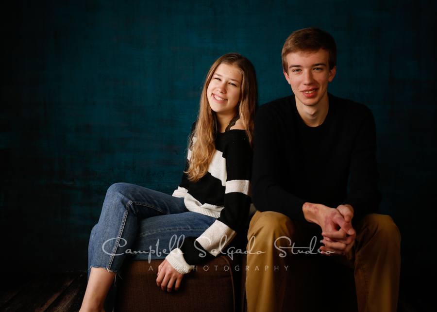 Portrait of teens on deep ocean background by family photographers at Campbell Salgado Studio in Portland, Oregon.