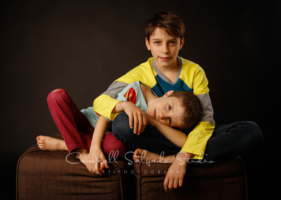 Portrait of boys on black background by child photographers at Campbell Salgado Studio in Portland, Oregon.